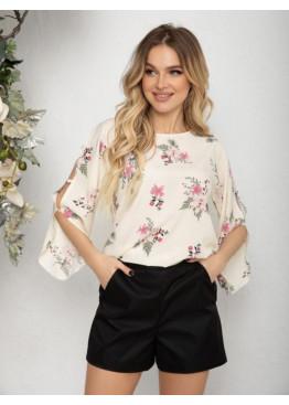 Белая блуза с вырезами на рукавах