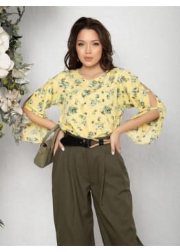 Желтая блуза с вырезами на рукавах